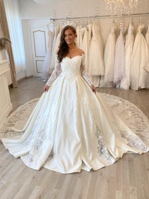 ROBE PRINCESSE BLANCHE ROBE DE MARIEE ROBE LONGUE MANCHES ROBE SIRENE ROBE ROYAL ROBE BOUFFANTE ROBE LONGUE MANCHE PERLE STRASS ROBE ECRUE ROBE IVOIRE ROBE LIBANAISE robe de mariée pour femme est composée de dentelle tissus en satin ou tulle, c'est une robe princesse, avec de longue manche , couleur ivoire ou blanche